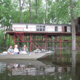 Many homes in the bayou are raised up on stilts, or pilings. The elevated height keeps them from flooding during storms.