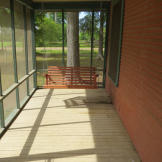 A screened-in patio is a must for enjoying those warm nights in the bayou...and to keep those pesky mosquitoes away.