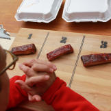 Tuffy inspects a set of ribs before judging them.