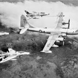 Witness the first triple-point refueling operation with three F-100c Super Sabres attached to a Boeing KB-50D Superfortress in 1956.