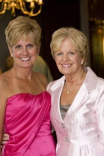 "Lori Allen from Say Yes to the Dress: Atlanta with her mother Jean. ""This was taken at my 50th birthday party two years ago. It's one of my favorite Mom pictures! Everyone had to wear pink to my party."""