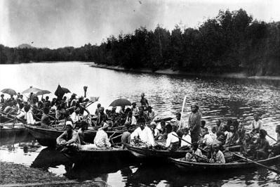 Sea gypsies navigate their boats through a river near Bangkok, Thailand.