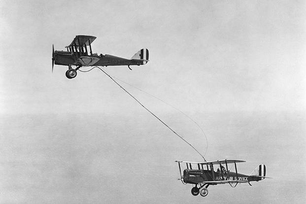 An image of the first aerial refueling performed by Captain Lowell H. Smith and Lt. John P. Richter on June 27, 1923. The DH-4B biplane remained in the air for 37 hours over San Diego, California.