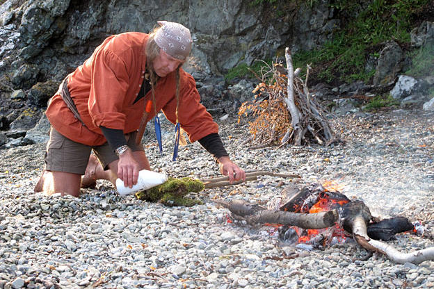 Cody makes torches using moss saturated with motor oil. Slightly damp moss soaked with a heavy fuel makes a excellent slow fire.