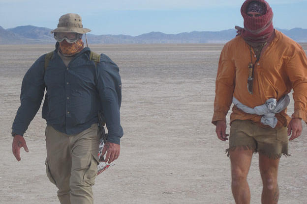On their way toward the high country rimming the basin, Cody and Dave are caught in one of the frequent dust storms that torment eyes and noses and suck the moisture out of your body at an accelerated rate.