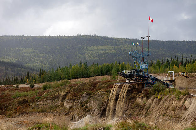 At a claim along the road from Dawson City, a massive wash plant processes multiple tailing streams. Mining operations - past and present - are the most common signs of civilization outside of town.