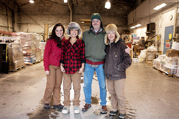 The flying Tweto family — Ayla, Ariel, Jim and Ferno — in one of the cargo hangars at the Unalakleet airport.