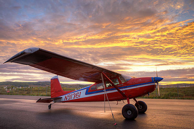 """Jim's beloved 1969 Cessna 180 is the only plane he still likes to fly. The 180 is a  great bush plane with """"tail-dragging"""" performance that keeps the prop up during off-airport landings."""