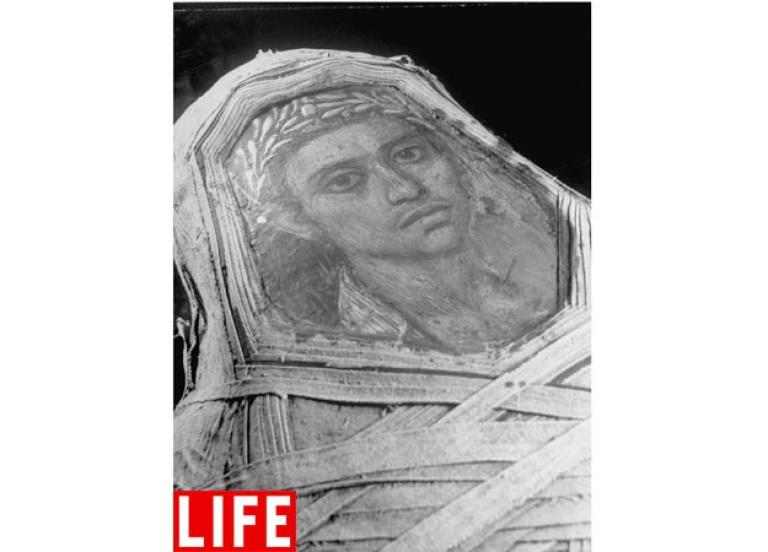 Commemorated in Portrait. This encaustic mummy portrait, done with hot wax and colored pigments, shows a burial from the Hellenistic period in the Egyptian collection of the Metropolitan Museum of Art in New York.