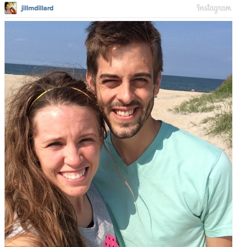 """Jill and Derick celebrate their """"weekiversary"""" on the beach near Kill Devil Hills, North Carolina, where they spent their honeymoon. The happy couple toured the Wright Brothers National Memorial, enjoyed a picnic lunch, and visited the Cape Hatteras lighthouse."""