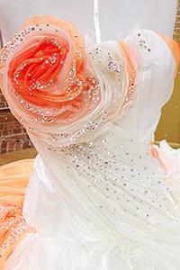 Read More Less An Orange Flower Detail On A Gypsy Wedding Dress